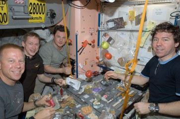 ISS-20_Crew_members_share_a_meal_at_a_galley_in_the_Unity_node_of_the_International_Space_Station